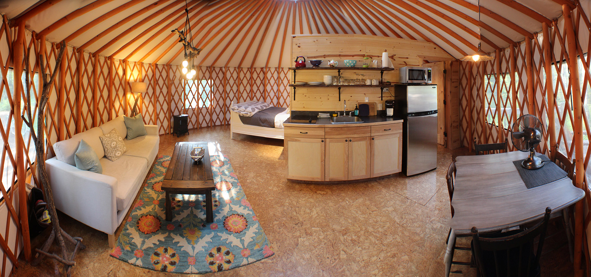 Outside the yurt is a deck with a barbeque, picnic table, and Adirondack  chairs to enjoy the view. A step away is a private fire pit with wood for a  ...