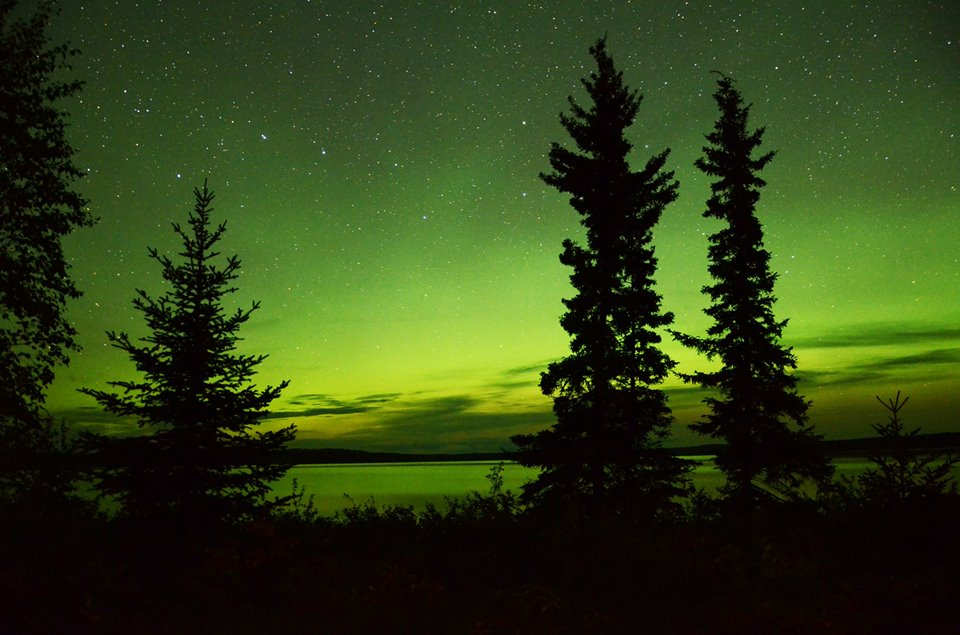 Northern lights cast their glow over Nesslin Lake, Sask.