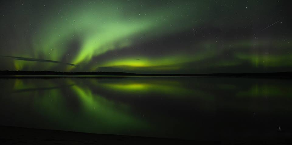 Northern lights dancing over Nesslin Lake, Sask.