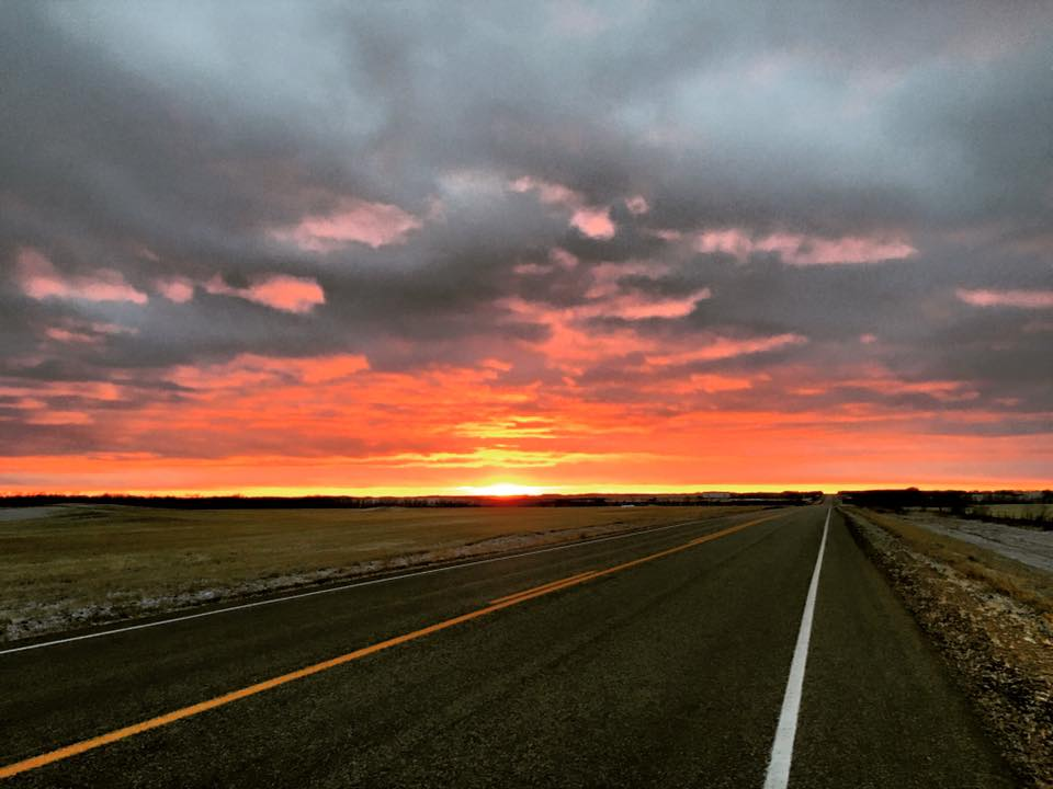 Sunset on highway 3 near Glaslyn, Sask.